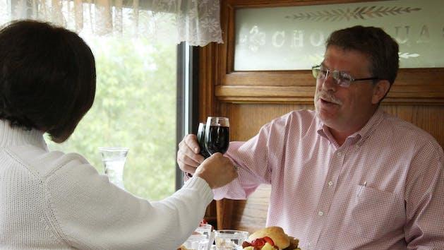 Couple Toasting Wine in Dining Car Chocorua