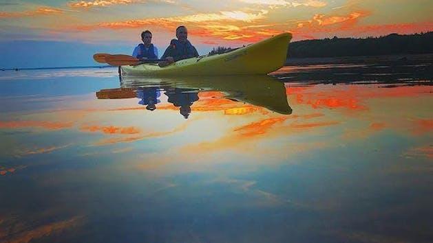 family sunset kayak trip