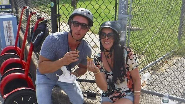 Segway couple with cheesesteak