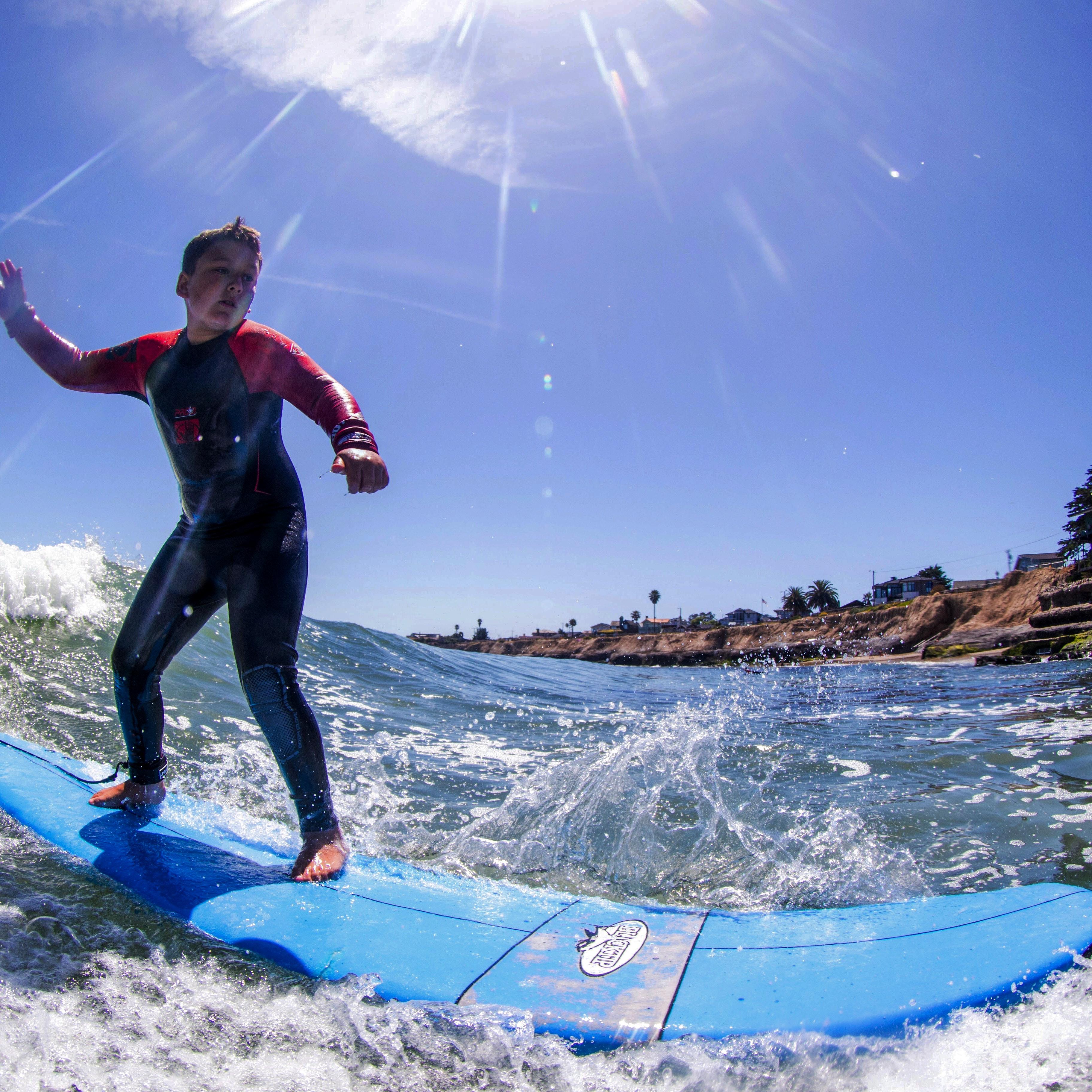 Boy learning to surf in Santa Cruz California