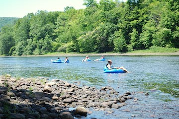 People relaxing and tubing down the river