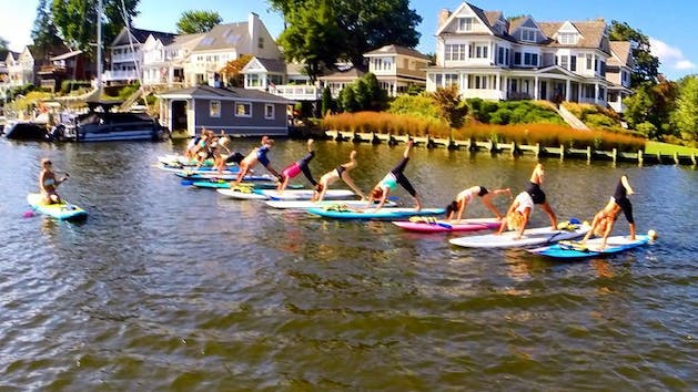 A group of People in a FloYo class in the nice sunny weather